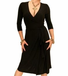 Almost perfect dress: sleeves, 3/4 sleeves, waistline. If it were fuschia, it would be killer.