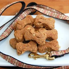Crunchy Peanut Butter Dog Treats...  Ingredients:    1 cup dry oats  2 cups whole wheat flour  1/2 cup smooth peanut butter  1/2 cup chunky peanut butter  1 cup water  1/4 cup canola oil(or virgin coconut oil)  1 egg, beaten  Directions: roll out, cut out any shape you like, bake at 350 for 20 mins, let cool 2 hours