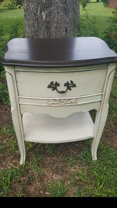 I used Dixie Belle Drop cloth and grunge glaze on the base and General Finishes Java Gel stain on top.