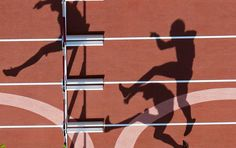 Athletes compete in the men's decathlon 110m hurdles heat
