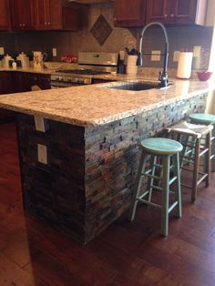 This bar has stacked slate around it, with rough edged granite counter tops. Love it! To see more - http://todd.southernrealtyspecialists.com/p/listing/mlsid/21/propertyid/582916/