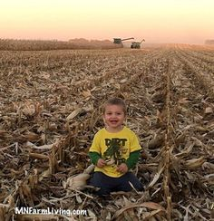 Kids on the farm enjoying the outdoors and harvest. Combining corn in the background. This little boy is my grandson. Grandchildren are so wonderful!