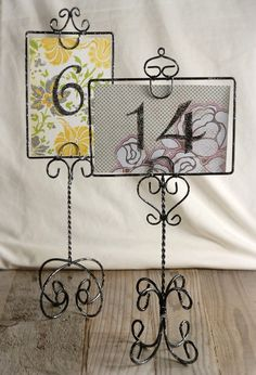 Table Number Holders (also like the idea of using fabric/scrapbook paper scraps for the numbers)