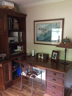 Desk, bookcase, and computer station.  Chair with Indian on horse and pony print, and vintage style lamp from two different catalog companies years ago.  Print of red tailed hawk by Charles Frace.  Covered wagon was a grade school project as part of Oregon Trial history unit.  I sometimes also put the boys kid sized cowboy hats and boots on top of bookcase unit.  I'm saving them for grand kids.
