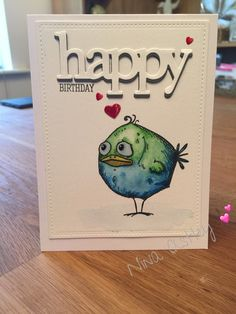 I love this Crazy Bird from Tim Holtz...I coloured using watercolours and the 'happy' die is from W plus 9