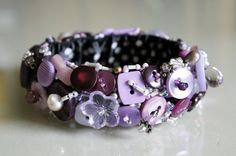 Hey, I found this really awesome Etsy listing at http://www.etsy.com/listing/77420501/button-jewelry-bracelet-purple-and