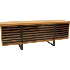 """USA  2011  A custom-built credenza in a saddle caramel leather wrap with solid Walnut and Rosewood doors by Thomas Hayes Studio. Bases are solid and are one piece. They pierce the lower edge and terminate into the top of the upper edge.Measurements  height: 33""""  depth: 22 1/2""""  width/length: 90"""""""