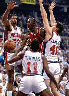 James Edwards, Isiah Thomas, Bill Laimbeer - Detroit Pistons and Michael Jordan - Chicago Bulls