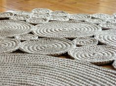 This crochet rug is made of 100% natural jute rope. I crochet jute string around jute rope to make spirals. It look`s cosy. I love the jute string, because it is sturdy and stretchy in the same time, so will have a long life. It is heavy rug and it will stable sit on its place. Measurements: