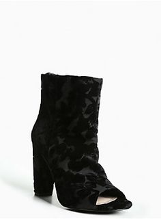 """A velvet shoe that crushes the competition. This peep toe bootie gets a lift with a lofty heel, but keeps it covered with a fabric upper. Detailed with a romantic floral velvet print all over, this is a style for the lovers.<div><ul><li style=""""LIST-STYLE-POSITION: outside !important; LIST-STYLE-TYPE: disc !important"""">TRUE WIDE WIDTH: Designed so you never have to size up again. For the perfect fit, we recommend going down a whole size.</li><li style=""""LIST-STYLE-POSITION: outside !important…"""