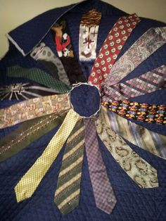 My latest project..just started last night...tie quilt made from all my dads old ties..still have about 40 ties to fit in and figure out the rest