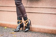 patent black boots from Louis Vuitton.
