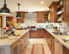 , Traditional L Shaped Kitchen Designs With Elegant Kitchen Island Also Dark Brown Industrial Pendant Lights Design Also Stainless Cooker And Exhaust Hood Also Brown Elegant Kitchen Cabinet Also Drawers: L Shaped Kitchen layout for Pretty Home