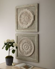 Medallion Wall Plaques at Horchow- 425USD each. DIY with mdf squares, apply ceiling medallions and paint.