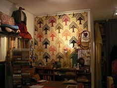 I love the antique pine tree and this is on the wall at Le Rouvray quilt shop in Paris, near Notre Dame.