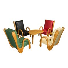 1950's Set of Four Armchairs and Table attributed to Jean Royere