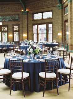 Slate blue wedding table decor: http://www.stylemepretty.com/illinois-weddings/chicago/2016/09/05/cafe-brauer-chicago-wedding/ Photography: Jacqui Cole - http://jacquicole.com/