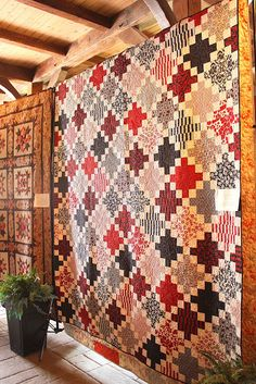 This quilt has been on my list for some time.  I've only seen it with dark chains, but this looks good too.