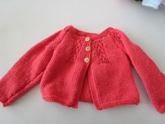 Our Knit & Natter Group created this beautiful red baby cardigan for sale!
