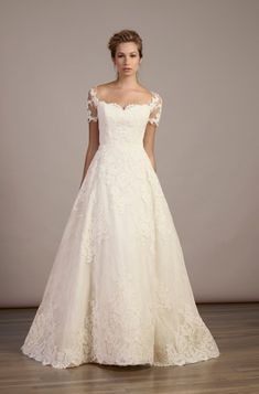 Style 5883 - Liancarlo. French Alencon lace on tulle overlay over Chantilly short sleeve A-line gown in Ivory.
