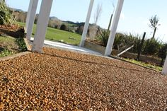Natural Paving stablises pebbles and provides a natural ambiance to your paths, patios and drives. Outdoor Rooms, Stables, Railroad Tracks, New Zealand, Landscaping, Natural, Courtyards, Yard Landscaping, Outdoor Spaces