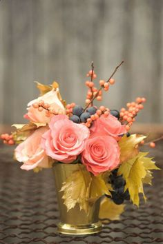 flower centerpieces with a fall flair but still has a brightness to them