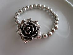 Hey, I found this really awesome Etsy listing at https://www.etsy.com/listing/221864290/silver-toned-rose-sculpted-pendant