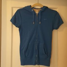 XS Nike hooded zip Blue with short sleeve and 2 front pockets. Nike Tops Sweatshirts & Hoodies