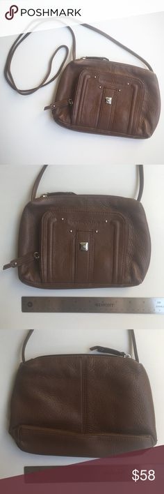 EUC Leather Stone Mountain Cross-Body Bag ⭐️SALE⭐️ Well-made, durable leather satchel purse with several pockets for storage. In EXCELLENT pre-owned condition, minimal signs of use. There are a few small colored spots on interior fabric, but exterior shows no signs of wear. Zipper closure. Perfect for the autumn/fall season!  From a clean, smoke-free home. See pics for measurements. Please ask any questions before purchasing. Thanks for visiting!  ✅ Offers Welcome  ✅ 20% OFF Bundles  ⛔️ No…