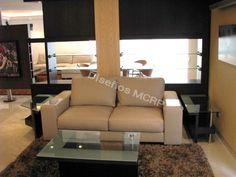Área de Estudio según diseño, Sofá en cuero Italiano, muebles en Wengue, alfombra de lana.
