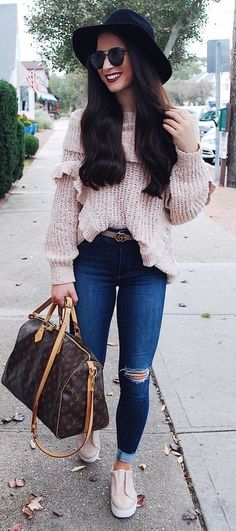#fall #outfits Women's pink knitted top, blue distressed jeans and brown Louis Vuitton leather bag