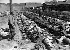 Bodies of some 400 Korean civilians lie in and around trenches in Taejon's prison yard during the Korean War in Sept. 1950. The victims were bound and slain by retreating Communist forces before the 24th U.S. Division troops recaptured the city Sept. 28. Witnesses said that the prisoners were forced to dig their own trench graves before the slaughter. Looking on, at left, is Gordon Gammack, war correspondent of the Des Moines Register and Tribune. (AP Photo/James Pringle) #