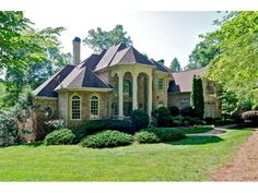 Private Gated 3.6 Acres nestled in Alpharetta with low Cherokee Co taxes.  Impressive foyer entry with marble tile