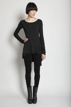 Black half boots + black tights + black skirt + tunicy black top