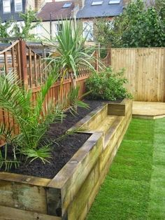Bench raised bed made of railway sleepers. This would be great for a small veggie garden.