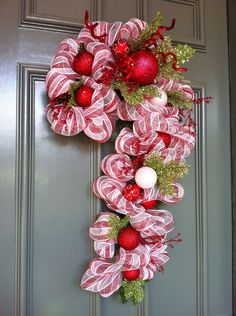 Items similar to Candy Cane shaped door wreath. Red and white metallic stripe. With apple green holly accents. on Etsy. , via Etsy.