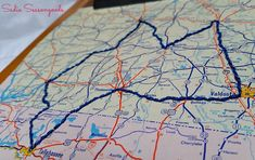 Or commemorate a road trip by stitching the route into one of them: | 20 Ways To Display Keepsakes From Your Travels And Trips