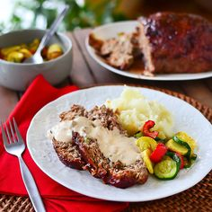 Jalapeno Jack Meatloaf with Creamy Mushroom Sauce - Juicy, tender meatloaf stuffed with cheese, onions, and jalapenos, and covered with creamy mushroom sauce. Mmm!
