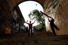 STAIRWAY TO HAVEN: Sri Lankan boys play a game of cricket on a stairway in their neighborhood in Colombo, Sri Lanka. (Eranga Jayawardena/AP)