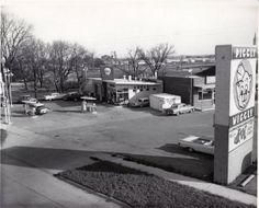 Janesville, Wisconsin history: Piggly Wiggly and East Side Shell on Milwaukee Street. Piggly Wiggly is now U-Haul.