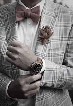 details: harmonising brown bow tie, flower and watch (wedding ring)
