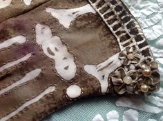 Hand-embroidered, tea-dyed and batiked bone gloves ( detail) by Joy Patterson for Twixt Piety and Desire
