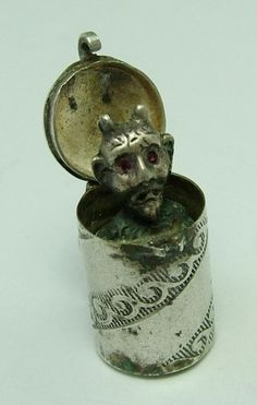 1930s European silver charm that opens to reveal a Devil that pops up on a spring, with red painted eyes - 85 GBP