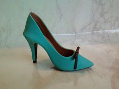 Check out this item in my Etsy shop https://www.etsy.com/listing/226431495/teal-pointed-toe-high-heel-shoe-with-a