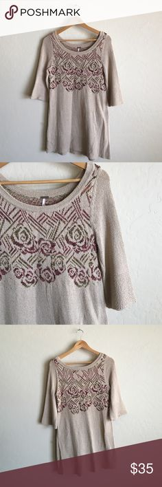 Pretty Free People sweater! Worn once Light brown color with muted floral patterns on front and back. Sleeve goes to about elbow. Very cute, great condition, worn once. Size XS but fits larger Free People Sweaters