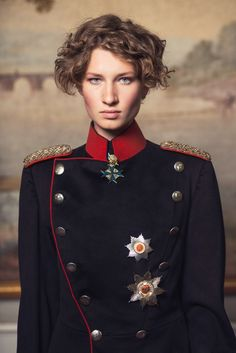 Eve's Glory by A. Tamboly, Modern media represents women narrowly: passive, delicate and feminine—a woman in military clothing is practically a visual impossibility. In this portrait series, women don vintage officer uniforms, thus questioning the highly masculine image of military glory and highlighting the proud independence of modern women.
