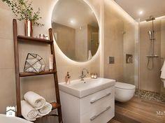 jasna łazienka z podświetlanym okrągłym lustrem