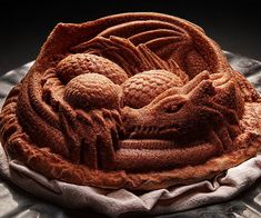 Bake up delicious mythical creatures the whole family will love using this dragon cake pan. It's made from heavy cast aluminum alloy and molded into a design that allows you to bake a fierce looking mother dragon guarding her precious eggs.