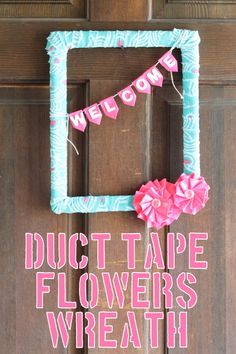 duct tape flowers wreath with fabric around frame.  Banner and flowers from tape, button as flower center