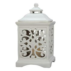 This handcrafted ceramic lantern boasts a beautiful ivory glazed finish that is sure to perfectly accent your patio or garden. The intricate design allows f